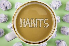 Handwriting text Habits. Concept meaning Regular tendency or practice Routine Usual Manners Behavior Pattern written on Tea in Whi. Handwriting text Habits Stock Image