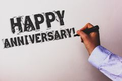 Handwriting text Happy Anniversary Motivational Call. Concept meaning Annual Special Milestone Commemoration Advisors hand holding. Black marker whiteboard stock photography