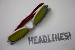 Handwriting text Headlines Motivational Call. Concept meaning Heading at the top of an article in newspaper Grunge ideas messages. White background sunglasses Royalty Free Stock Images