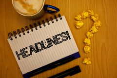 Handwriting text Headlines Motivational Call. Concept meaning Heading at the top of an article in newspaper Ideas grunge notebook. Coffee cup crumpled papers stock photography