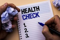 Handwriting text Health Check. Concept meaning Medical Examination Diagnosis Tests to prevent diseases written by Man on Notebook. Handwriting text Health Check stock photo