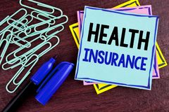 Handwriting text Health Insurance. Concept meaning Health insurance information coverage healthcare provider written on Sticky Not. Handwriting text Health royalty free stock photo