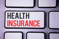 Handwriting text Health Insurance. Concept meaning Health insurance information coverage healthcare provider written on white keyb. Handwriting text Health royalty free stock photo