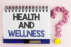 Handwriting text Health And Wellness. Concept meaning being in good shape Healthy food workout drink water written on Notebook Boo. Handwriting text Health And Royalty Free Stock Photo