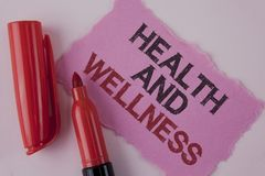 Handwriting text Health And Wellness. Concept meaning being in good shape Healthy food workout drink water written on Tear Pink St. Handwriting text Health And Stock Photography
