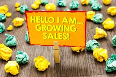 Handwriting text Hello I Am... Growing Sales. Concept meaning Making more money Selling larger quantities Paperclip hold written y. Ellow page colorful paper stock image