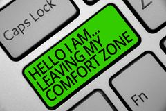 Handwriting text Hello I Am... Leaving My Comfort Zone. Concept meaning Making big changes Evolution Growth Keyboard green key Int royalty free stock photo