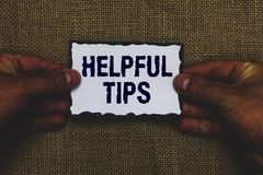 Handwriting text Helpful Tips. Concept meaning Useful secret Information Advice given to accomplish something Man holding piece pa. Per black borders jute stock images