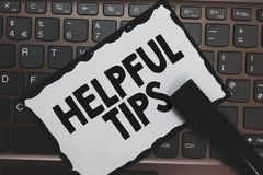 Handwriting text Helpful Tips. Concept meaning Useful secret Information Advice given to accomplish something White paper keyboard. Inspiration communicate royalty free stock photo