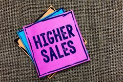 Handwriting text Higher Sales. Concept meaning The average sold products and services of a company has grown Paper notes Important stock photos