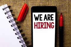 Handwriting text We Are Hiring. Concept meaning Talent Hunting Job Position Wanted Workforce HR Recruitment written on Mobile Phon. Handwriting text We Are Stock Photos