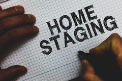 Handwriting text Home Staging. Concept meaning Act of preparing a private residence for sale in the market Man holding marker comm. Unicating ideas important royalty free stock photos