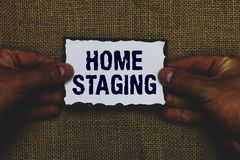 Handwriting text Home Staging. Concept meaning Act of preparing a private residence for sale in the market Man holding piece paper. Black borders jute royalty free stock photo