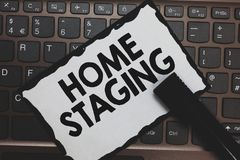 Handwriting text Home Staging. Concept meaning Act of preparing a private residence for sale in the market White paper keyboard In. Spiration communicate ideas royalty free stock photos