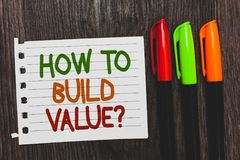 Handwriting text How To Build Value question. Concept meaning Ways for developing growing building a business Colorful words with. White page red green orange royalty free stock photography