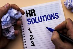 Handwriting text Hr Solutions. Concept meaning Recruitment Solution Consulting Management Solving Onboarding written by Man on Not. Handwriting text Hr Solutions Stock Image