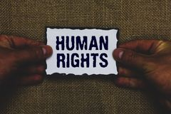 Handwriting text Human Rights. Concept meaning Moral Principles Standards Norms of a people protected by Law Man holding piece pap. Er black borders jute royalty free stock photography