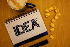 Handwriting text Idea. Concept meaning Creative Innovative Thinking Imagination Design Planning Solutions Ideas grunge notebook co. Ffee cup crumpled papers stock photos