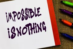 Handwriting text Impossible Is Nothing. Concept meaning Anything is Possible Believe the Realm of Possibility Open. Notebook page jute background colorful royalty free stock images