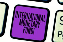 Handwriting text International Monetary Fund. Concept meaning promotes international financial stability Keyboard key. Intention to create computer message stock photo