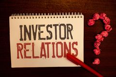 Handwriting text Investor Relations. Concept meaning Finance Investment Relationship Negotiate Shareholder Reddish paper balls str. Uctures question mark red pen royalty free stock images