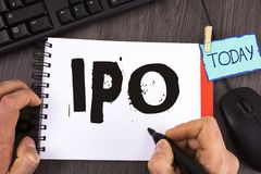 Handwriting text Ipo. Concept meaning Initial Public Offering First time stock of company is offered to public written by Man on N. Handwriting text Ipo. Concept Royalty Free Stock Photo