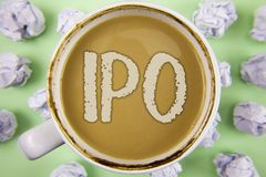 Handwriting text Ipo. Concept meaning Initial Public Offering First time stock of company is offered to public written on Tea in W. Handwriting text Ipo. Concept Stock Photography