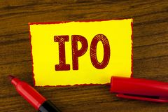 Handwriting text Ipo. Concept meaning Initial Public Offering First time stock of company is offered to public written on Yellow S. Handwriting text Ipo. Concept Royalty Free Stock Image