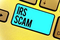 Handwriting text Irs Scam. Concept meaning targeted taxpayers by pretending to be Internal Revenue Service Keyboard blue key Inten. Tion create computer Stock Photography