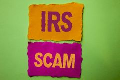 Handwriting text Irs Scam. Concept meaning Warning Scam Fraud Tax Pishing Spam Money Revenue Alert Scheme written on Tear Papers o Royalty Free Stock Photography