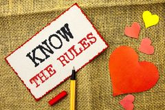 Handwriting text Know The Rules. Concept meaning Be aware of the Laws Regulations Protocols Procedures written on Sticky Note Pape. Handwriting text Know The royalty free stock photos
