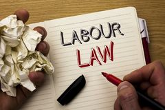 Handwriting text Labour Law. Concept meaning Employment Rules Worker Rights Obligations Legislation Union written by Man on Notebo. Handwriting text Labour Law Stock Photo