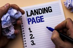 Handwriting text Landing Page. Concept meaning Website accessed by clicking a link on another web page written by Man on Notebook. Handwriting text Landing Page Stock Image