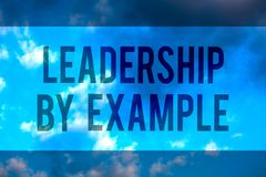 Handwriting text Leadership By Example. Concept meaning Becoming role model for people Have great qualities Multiline. Text desktop natural blue sky cloudy stock photo