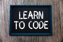 Handwriting text Learn To Code. Concept meaning Learn to write Software Be a Computer Programmer Coder.  royalty free stock photos