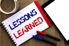 Handwriting text Lessons Learned. Concept meaning Experiences that should be taken into account in the future written on Notebook. Handwriting text Lessons Stock Photography