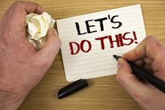 Handwriting text Let Us Do This Motivational Call. Concept meaning Encourage to start something Inspirational Text two words white. Paper note black marker hand stock photo
