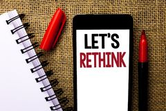 Handwriting text Let Us Rethink. Concept meaning Give people time to think things again Remodel Redesign written on Mobile Phone o. Handwriting text Let Us stock image