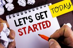 Handwriting text Lets Get Started. Concept meaning beginning time motivational quote Inspiration encourage written by Man on Notep. Handwriting text Lets Get royalty free stock image