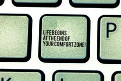 Handwriting text Life Begins At The End Of Your Comfort Zone. Concept meaning Make changes evolve grow Keyboard key. Intention to create computer message royalty free stock images