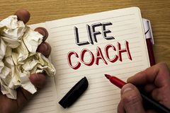 Handwriting text Life Coach. Concept meaning Mentoring Guiding Career Guidance Encourage Trainer Mentor written by Man on Notebook. Handwriting text Life Coach Stock Photos
