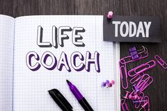 Handwriting text Life Coach. Concept meaning Mentoring Guiding Career Guidance Encourage Trainer Mentor written on Notebook Book o. Handwriting text Life Coach stock photos