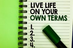 Handwriting text Live Life On Your Own Terms. Concept meaning Give yourself guidelines for a good living Written letters and numbe. Rs on notepad laid green stock photography