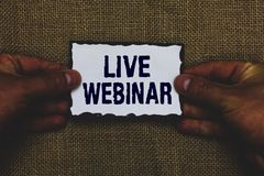 Handwriting text Live Webinar. Concept meaning Interactive seminar transmitted over the web Real Time Man holding piece paper blac