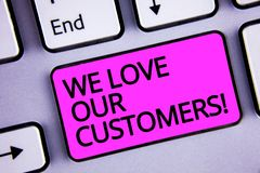 Handwriting text We Love Our Customers Call. Concept meaning Client deserves good service satisfaction respect Keyboard purple key. Intention create text Royalty Free Stock Photos
