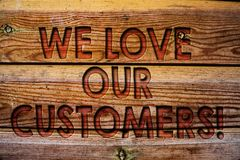 Handwriting text We Love Our Customers Call. Concept meaning Client deserves good service satisfaction respect Wooden background v. Intage wood board wild Stock Image