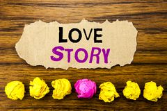Handwriting text   Love Story. Concept for Loving Someone Heart  Written on sticky note paper reminder, wooden background with sti. Handwriting text   Love Story Royalty Free Stock Image