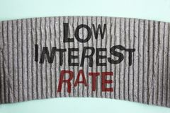 Handwriting text Low Interest Rate. Concept meaning Manage money wisely pay lesser rates save higher written on Cardboard piece on. Handwriting text Low Interest royalty free stock image
