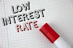 Handwriting text Low Interest Rate. Concept meaning Manage money wisely pay lesser rates save higher written on Notebook Paper Mar. Handwriting text Low Interest royalty free stock image