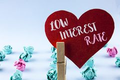 Handwriting text Low Interest Rate. Concept meaning Manage money wisely pay lesser rates save higher written on Red Paper Heart ho. Handwriting text Low Interest royalty free stock photography